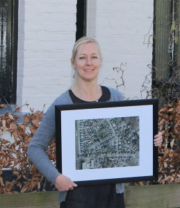 FIGURE 1. One of Dotka's early non-GIS customers poses here with a framed picture of her house and neighborhood. Initially focusing on the consumer market, Dotka became a popular site for accessing maps and historic imagery for areas of interest.