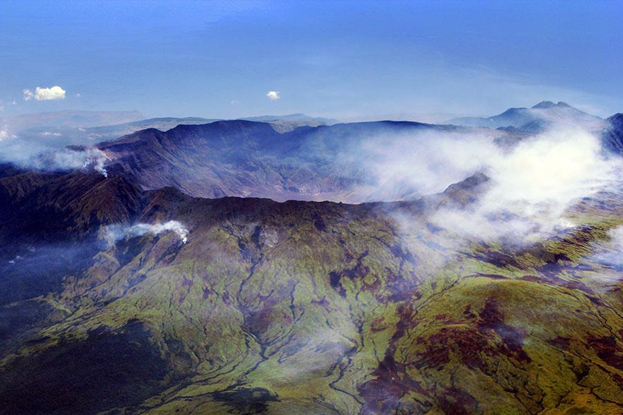 FIGURE 2. The 1815 eruption of Mount Tambora formed a huge caldera in Indonesia. Source: Jialiang Gao, see http:// en.wikipedia. org/wiki/Mount_ Tambora#/ media/ File:Caldera_ Mt_Tambora_ Sumbawa_ Indonesia.jpg