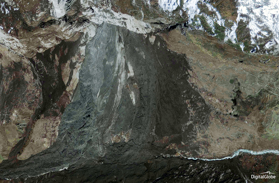 FIGURES 1-2. These images show a massive landslide in the Langtang area of Nepal, before (Figure 1, March 17, 2011) and after (Figure 2, May 3, 2015) the earthquake that occurred on April 25, 2015. A second quake hit on May 12. Langtang is a region with a national park in the Himalayas to the north of the Kathmandu Valley and bordering Tibet. Images courtesy of DigitalGlobe.