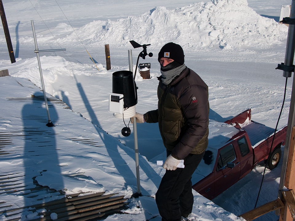 Figure 3. Paul Lawrence of SRB&A installing a weather station in Wainwright to contribute to the understanding of local marine subsistence activities. Photo credit: Caleb Billmeier.