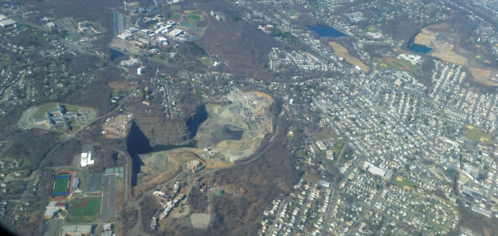 FIGURE 1. Seen from an airplane, the rapidly growing sprawling urban areas and open pit mines can be compared to malignant skin cancer. Aerial photo near Newark, New Jersey, courtesy of author.