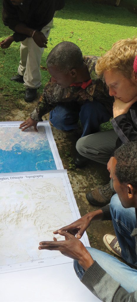 FIGURE 3. Participatory mapping in the Bale Mountains of Ethiopia using satellite imagery and local experts. Courtesy of M. Laituri.
