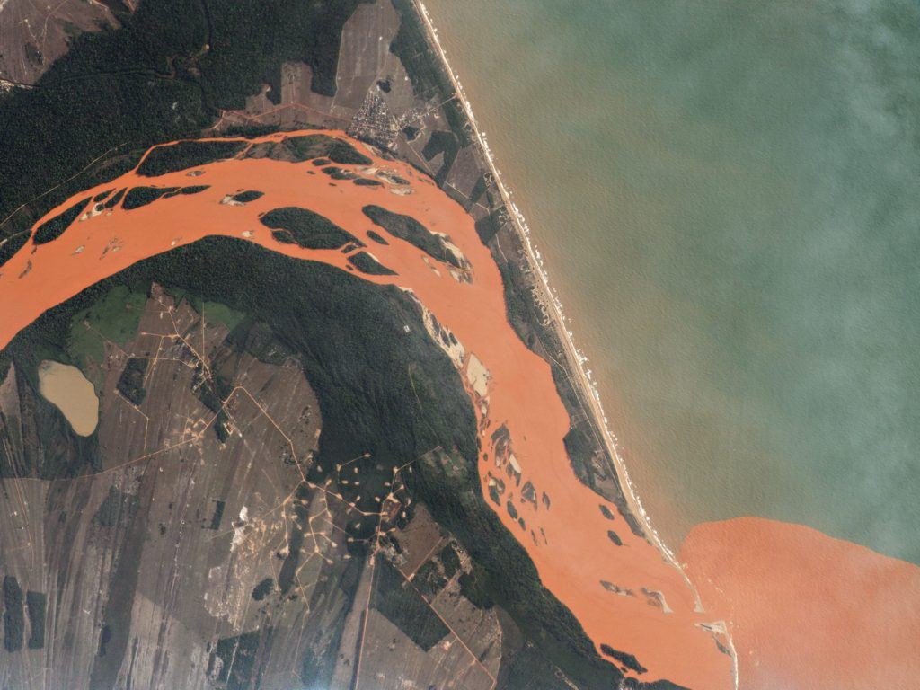 FIGURE 1. In the weeks following the Bento Rodrigues Dam failure in Brazil, which was Nov. 15, 2015, the Rio Doce has carried water contaminated with iron-mining waste 300 miles to its mouth in the Atlantic Ocean. Image: Planet Labs, captured November 29, 2015