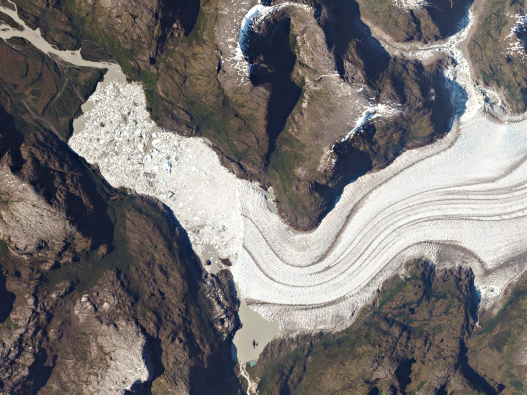 FIGURE 4. Massive icebergs and an ice mélange ll the lake at the toe of Occidental Glacier Bernardo O'Higgins National Park, Chile. The glacier drains the Southern Patagonia Ice Field. Researchers use Planet's frequent, wide-area imagery to monitor and measure glacial movement and melt. Image: Planet Labs, captured January 10, 2016